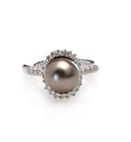 A black cultured pearl, diamond and white gold ring