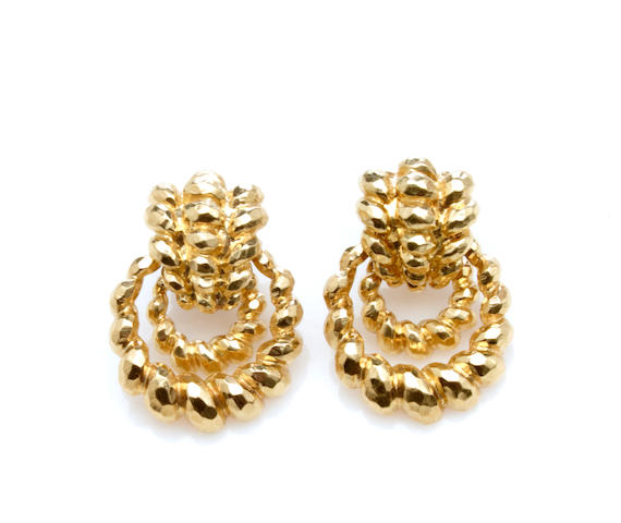 A pair of 18k gold earrings