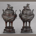 A pair of patinated bronze tripod censers Late Meiji/Taisho period