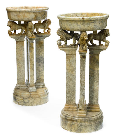 A pair of Neoclassical style alabaster jardinières on stands