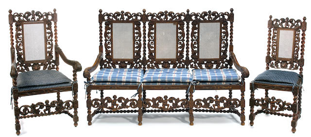 A suite of Charles II style carved walnut seat furniture