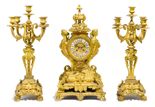 A French gilt bronze clock garniture <BR />possibly by Alfred Beurdeley<BR />third quarter 19th century