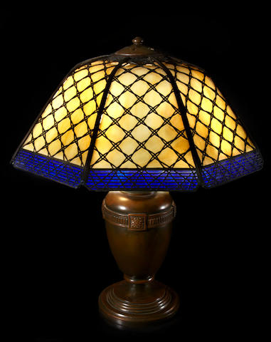 A Handel patinated metal and glass basketweave lamp early 20th century