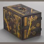 A gold and black lacquered rectangular writing chest 19th century
