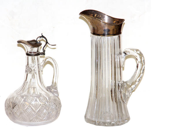 A silver mounted cut glass pitcher and claret jug early 20th century