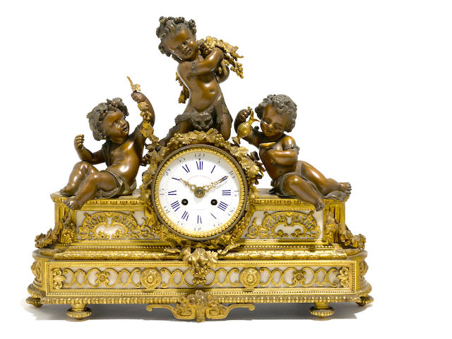 A French gilt and patinated bronze mantel clock <BR />late 19th century