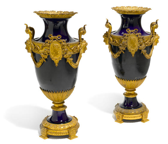 A pair of French gilt bronze mounted porcelain urns <BR />late 19th century