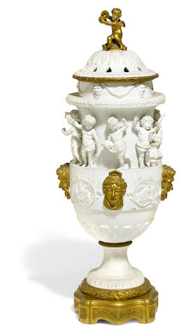 A Sevres style bisque porcelain gilt bronze mounted covered urn <BR />late 19th century