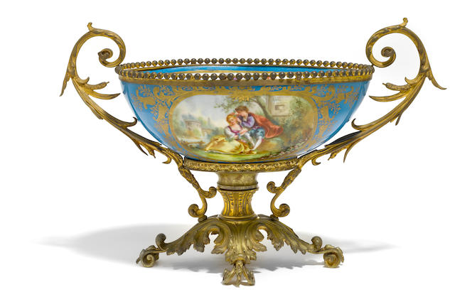 A Sèvres style gilt bronze mounted porcelain centerpiece <BR />late 19th/early 20th century