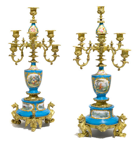 A pair of French gilt bronze mounted porcelain seven light candelabra