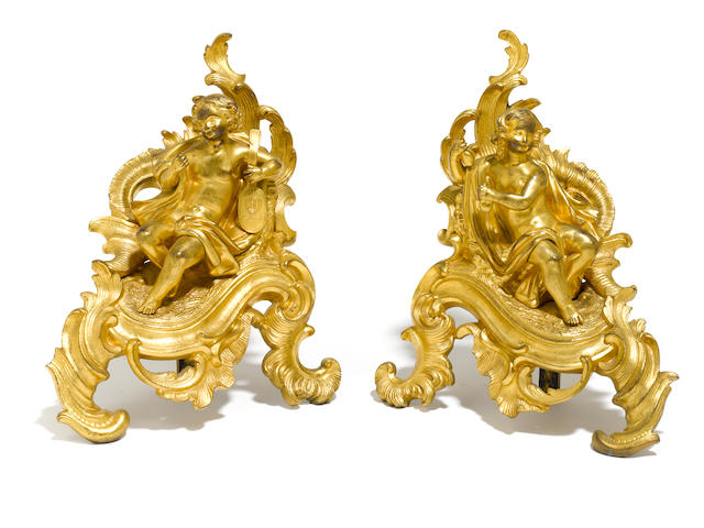 A pair of Louis XV style gilt bronze chenets <BR />second half 19th century