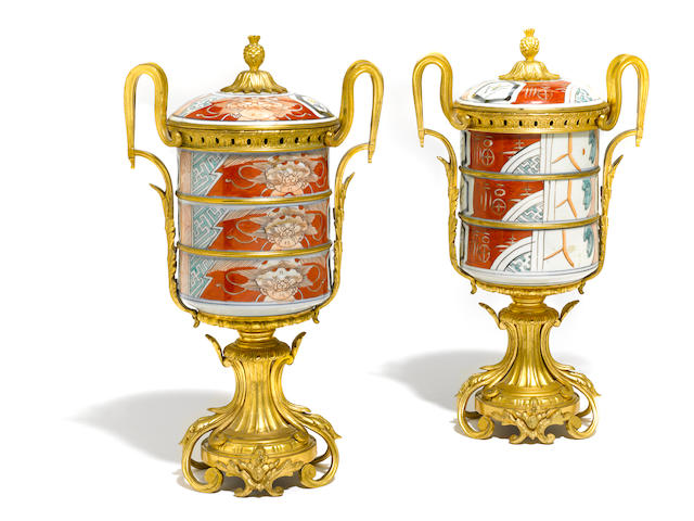 A pair of French gilt bronze and Chinese porcelain covered urns <BR />bronze late 19th century