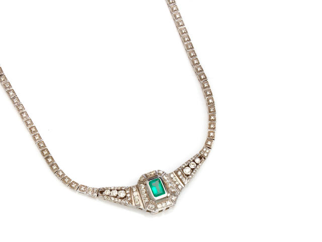An emerald, diamond and white gold necklace