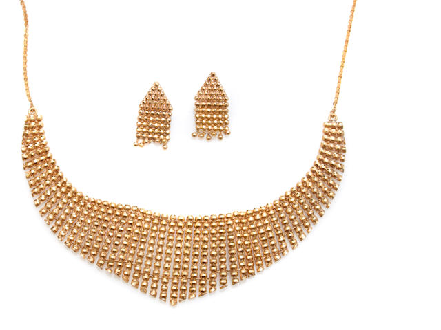 An 18k gold bib necklace and matching pair of earrings