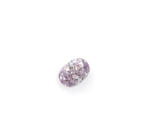 An unmounted colored oval brilliant-cut diamond