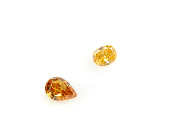 Two unmounted colored diamonds