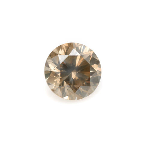 An unmounted round brilliant-cut colored diamond