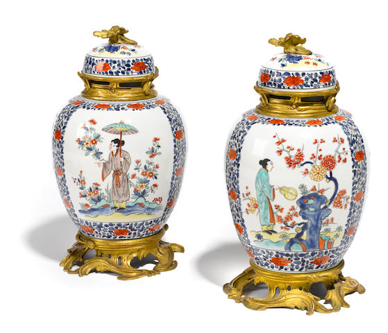 A pair of French gilt bronze mounted Kakiemon style porcelain covered  urns  <BR />probably Samson & Co., Paris<BR />late 19th century