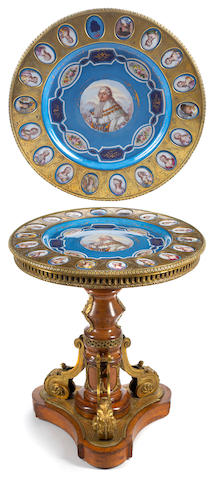 A Napoleon III gilt bronze and porcelain mounted mixed wood center table  late 19th century