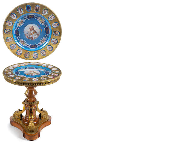 A Napoleon III gilt bronze and porcelain mounted mixed wood center table <BR />late 19th century