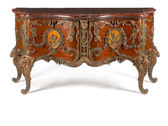 A Louis XV style gilt bronze mounted parquetry inlaid walnut commode <BR />after a model by Antoine Gaudreau<BR />circa 1900