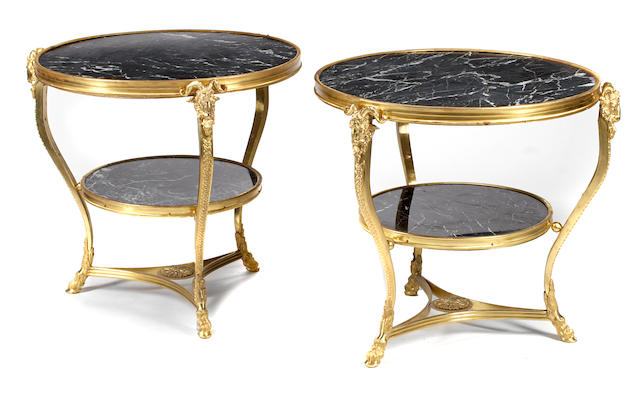 A pair of Louis XVI style gilt bronze and marble tables