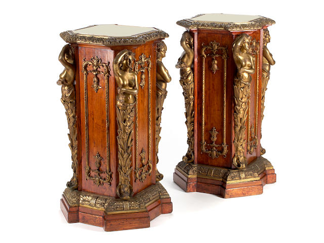 A pair of Napoleon III gilt bronze mounted walnut pedestals <BR />third quarter 19th century
