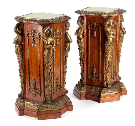 A pair of Napoleon III gilt bronze mounted walnut pedestals  third quarter 19th century