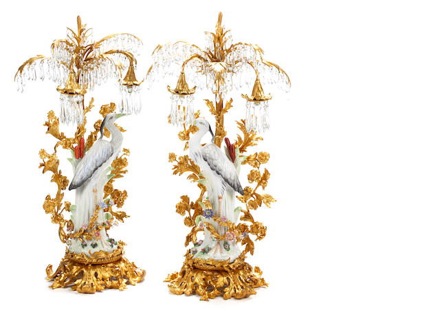 An imposing pair of Rococo style gilt bronze and porcelain table lamps