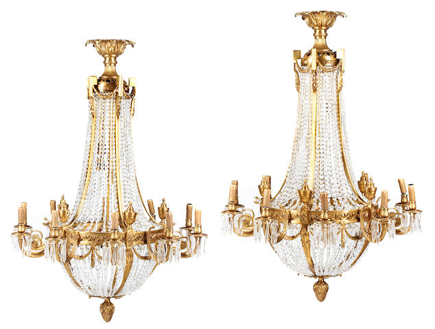 A pair of Neoclassical style gilt bronze ten light chandeliers