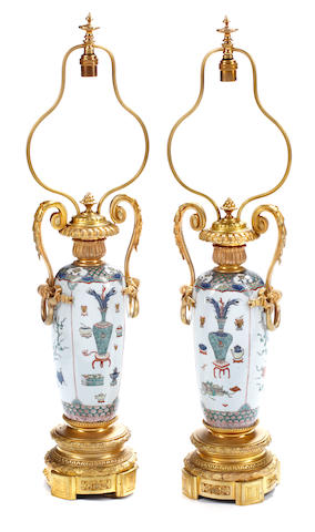 A pair of Chinese porcelain and gilt bronze mounted table lamps