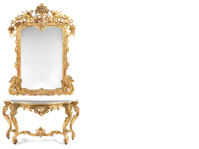 An Italian Rococo style carved giltwood console and mirror