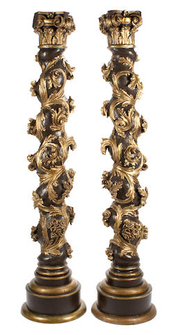 A pair of Continental Baroque parcel gilt and paint decorated columns  18th century