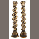 A pair of Continental Baroque parcel gilt and paint decorated columns