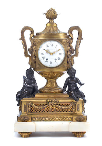 A Louis XVI style gilt and patinated bronze mantel clock <BR />late 19th century