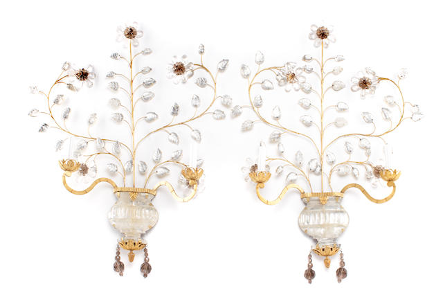 A pair of Neoclassical style gilt metal, rock crystal and smoky quartz two light wall sconces