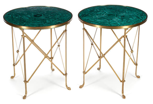 A pair of Louis XVI style gilt bronze and malachite veneered gueridons