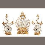 An imposing Rococo style gilt bronze and Chinese porcelain clock garniture
