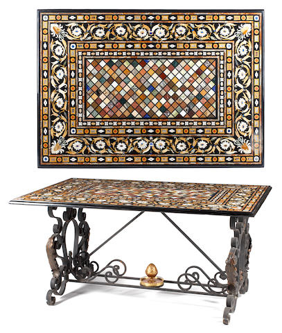 A Baroque style pietra dura and parcel gilt wrought iron center table