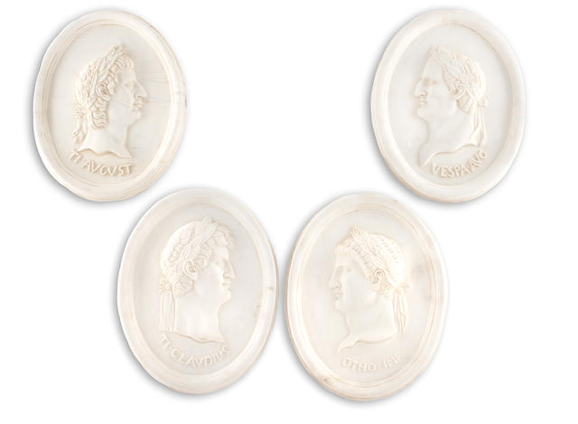 A set of four carved marble oval relief portrait panels