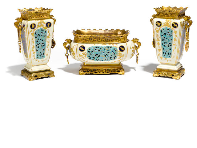 A garniture of three French gilt bronze mounted earthenware vessels <BR />late 19th century