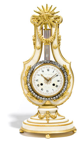 A Louis XVI style gilt bronze and marble mantel clock <BR />late 19th century