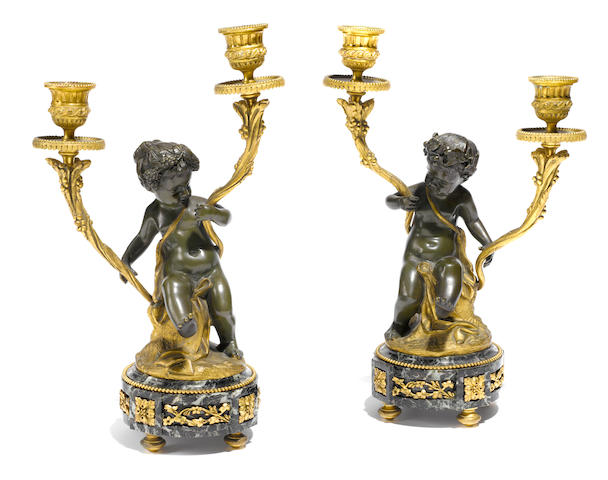 A pair of Louis XVI style gilt and patinated bronze figural two light candelabra  after models by Clodion  late 19th century