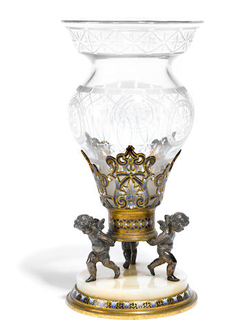 A French gilt and silvered bronze champleve enamel and glass vase <BR />late 19th century