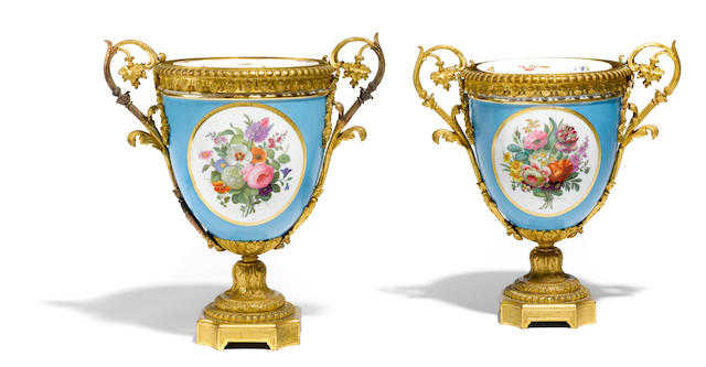 A pair of French gilt bronze mounted porcelain urns  late 19th/early 20th century
