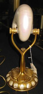 A Tiffany & Co. Studios gilt bronze and nautilus lamp<BR />1899-1918
