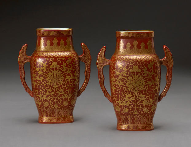 A pair of coral red and gilt decorated porcelain vases Jiaqing mark, late 19th century