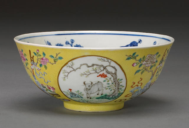 A yellow sgraffito ground porcelain bowl with famille rose and underglaze blue ram roundels Guangxu mark