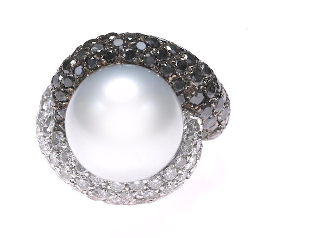A South Sea cultured pearl, diamond and black diamond bypass ring