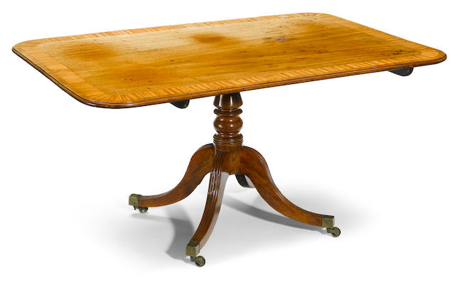A Regency rosewood and satinwood crossbanded mahogany tilt top breakfast table  <BR />early 19th century